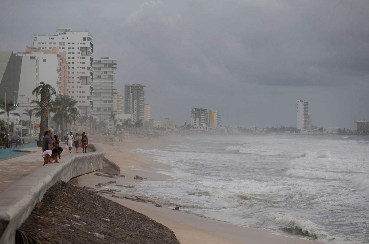 Tourists walk along the Malecon as storm Pamela approaches the Pacific coast resort, in Mazatlan, Mexico, October 12, 2021. REUTERS/