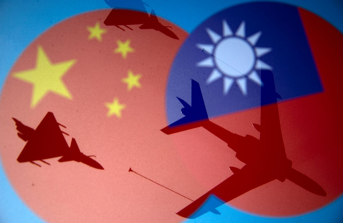 Chinese and Taiwanese national flags are displayed alongside military airplanes in this illustration taken April 9, 2021. REUTERS/Dado Ruvic/Illustration